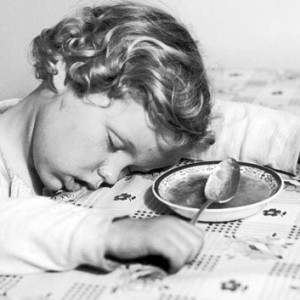 child_sleeping_at_table